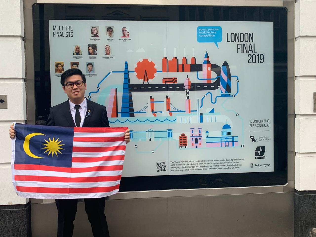 Jia Yong with the Jalur Gemilang in front of the Institute of Materials, Minerals and Mining (IOM3)